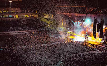 KISS performs behind a blast of white confetti at Chicago Open Air